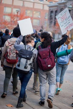 Rachel Mitchell (left) and Lashelle Ramirez (Right), both juniors, march together in Wednesday's 'Sanctuary Campus' protest.