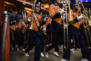 The Syracuse band comes marching in before the team's first home game against Rhode Island.