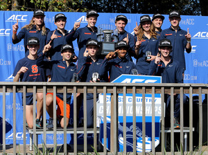 Syracuse's men's cross country team celebrates its 2015 Atlantic Coast Conference championship. The Orange won again in 2016.