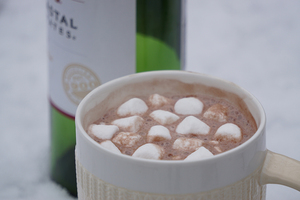 Make some hot chocolate, put some wine in it, top with marshmallows or whipped cream, and enjoy.