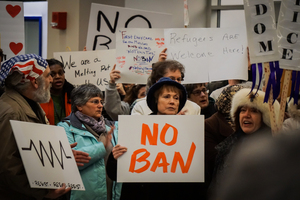 After President Donald Trump signed his executive order on travel and refugee ban in January, hundreds protested  at Syracuse Hancock International Airport.