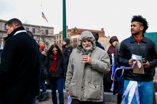 Demonstrators endure the cold weather as they marched with Vera House, which provides shelter, advocacy and counseling services to victims of abuse.