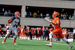 Freshman midfielder Jamie Trimboli gets ready to make a move on the SJU defender.