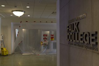 The area inside Falk College's White Hall is blocked off as crews work inside the building. Photo taken July 5, 2017